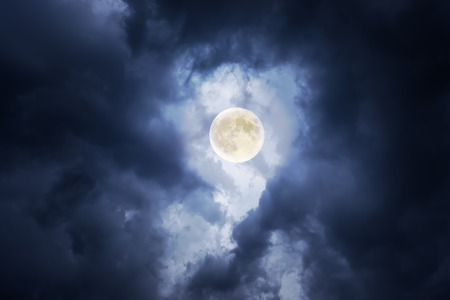sky: supermoon in clouds Stock Photo