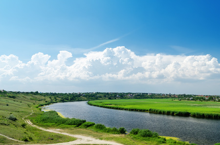 blue green landscape: river in green landscape and clouds with blue sky