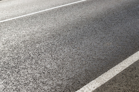 white lines: asphalt road closeup with white lines