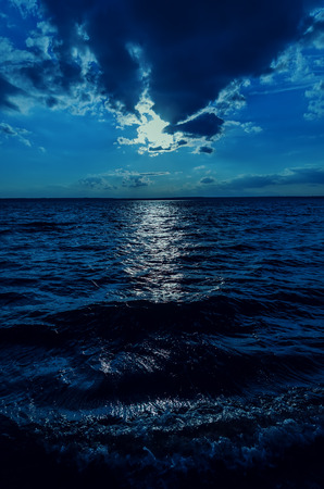 water wave: moonlight in sky over dark water