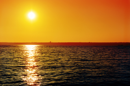 orange sunset: orange sunset over dark river