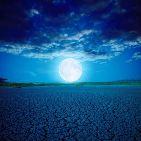 moon crater: full moon over desert in night Stock Photo