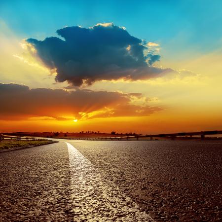 over: dramatic sunset over asphalt road closeup