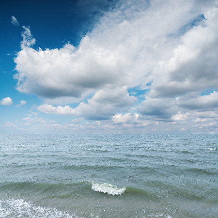 blue cloudy sky: blue sea and cloudy sky over it