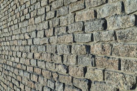 granite wall: stones wall. granite bricks. soft focus