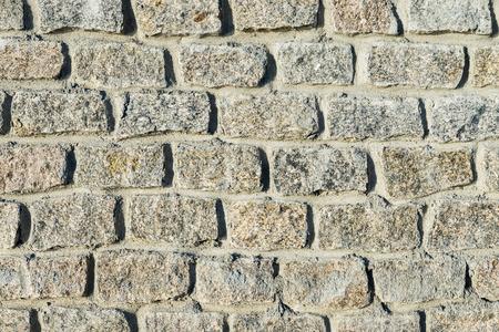 granite wall: stones wall. granite bricks as background Stock Photo