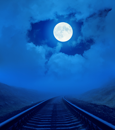 railroad: full moon in clouds over railroad
