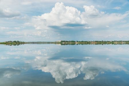 sky reflection: dramatic clouds in sky and river reflection