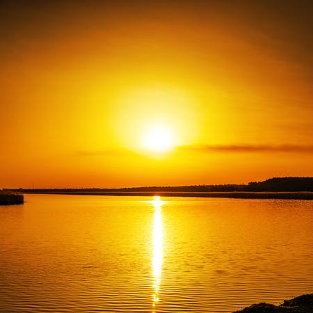 orange sunset: good orange sunset over river