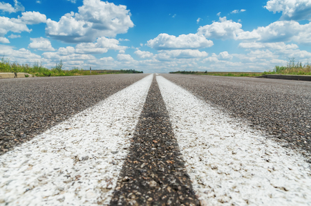 solid background: two white line on asphalt road closeup