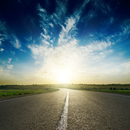 trip over: sunset in deep blue sky over road