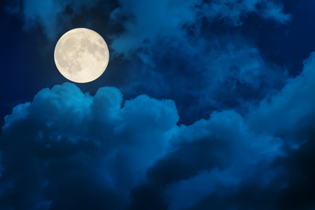 supermoon in dramatic clouds Stock Photo