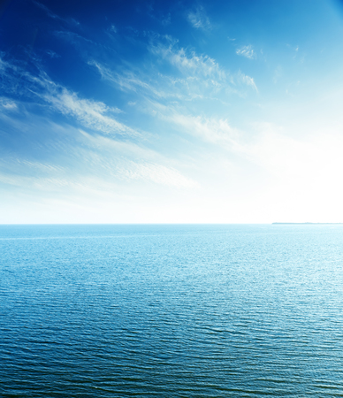 sunset sky: perfect sunset in blue sky over sea. aerial view
