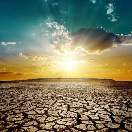orange sunset: orange sunset over drought earth Stock Photo