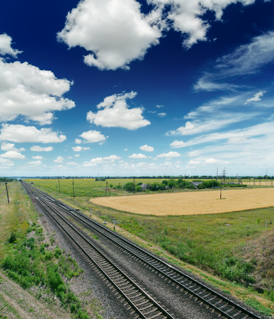 railroad to horizon in blue sky with clouds Stock Photo