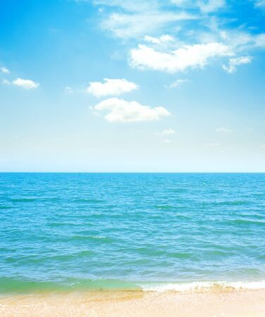 blue sky with clouds and sea with yellow sand Reklamní fotografie