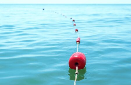 red buoys on the water tied with a rope Reklamní fotografie