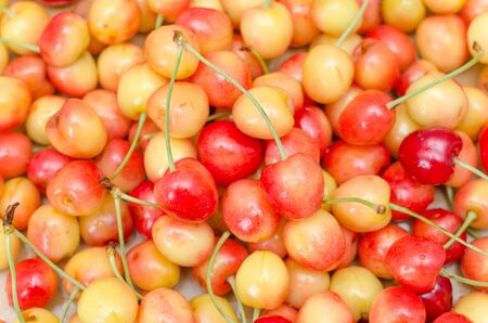red and yellow cherry as background