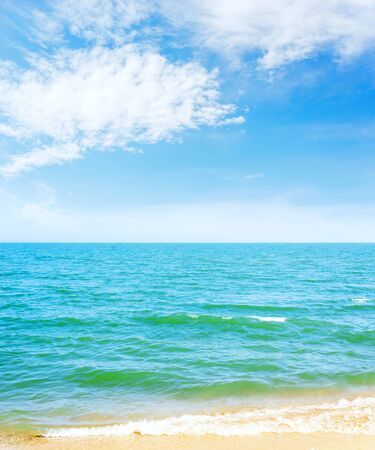 blue sky with clouds over sea and yellow sand 스톡 콘텐츠