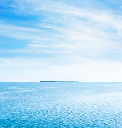 blue sea water and white clouds in sky