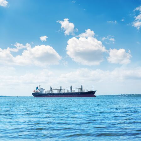 big ship in river and blue sky with clouds 스톡 콘텐츠