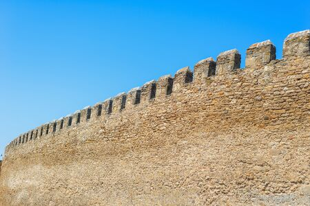 old citadel wall on blue sky background 스톡 콘텐츠