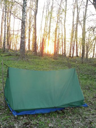 unprofessional: The tent in the wood. The diletantish tourism. Stock Photo