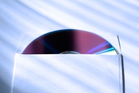 compact disk: The compact disk into envelope.