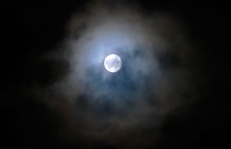 The moon covered dark clouds. Stock Photo - 5368058