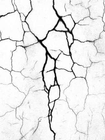 壁のクローズ アップに亀裂。黒と白。