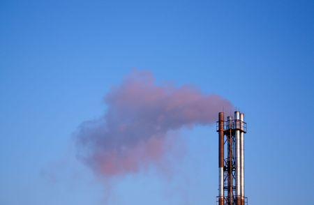 futurity: The chimney-stalk against blue sky.