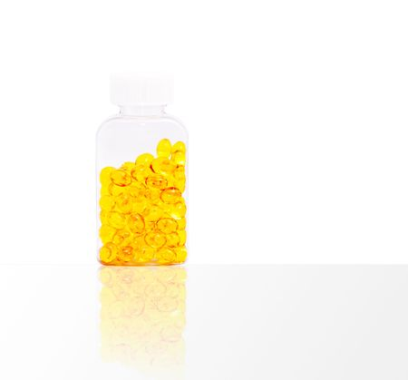 The vial with pills on a white background. photo