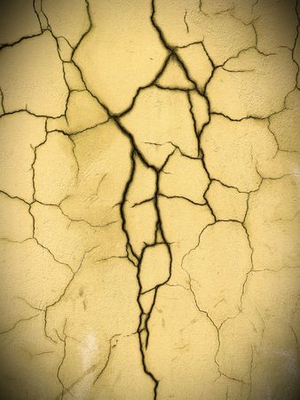 damaged: The crack on the wall close-up. Stock Photo