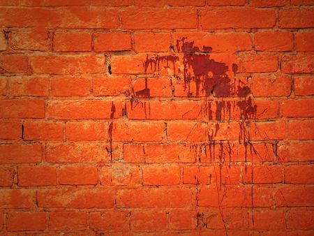 The fragment wall of brick dirty blood. photo