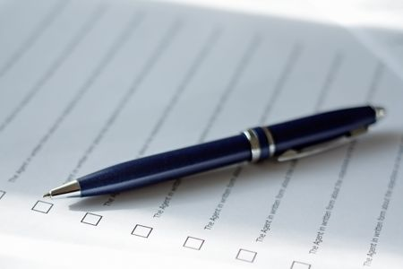 Pen and clause of an agreement. Stock Photo