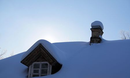 The roof of the country-house. Christmas morning. Stock Photo - 8196567