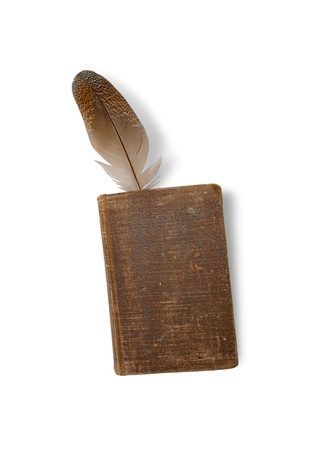 Old book and feather on a white background. Stock Photo - 8898977