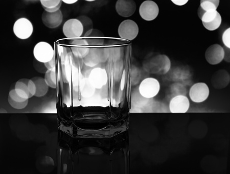 The empty whisky glass closeup. Black and white. photo
