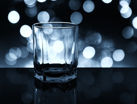 The empty whisky glass closeup. photo