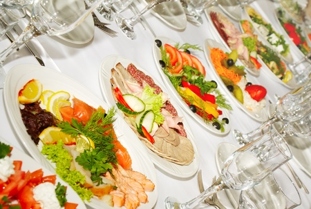 The served dinner table in a restaurant.  photo