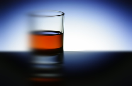 signle: The whisky glass at night. Stock Photo