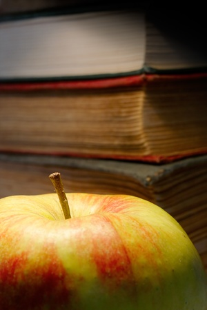 The old books and apple. photo