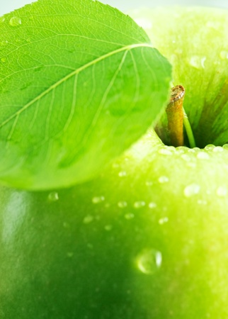 Green apple with a leaf. photo