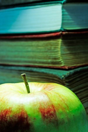 The old books and apple. Cross-processing. photo