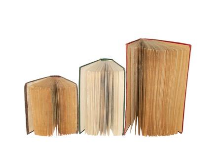 Three open books on white. photo
