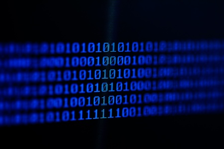 Binary code on a computer monitor. photo