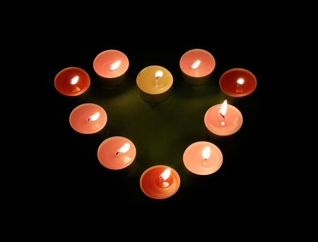 Candles in the shape of heart. photo