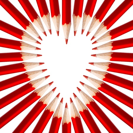 Red pencils in a shape of heart.  photo