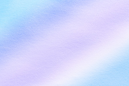 multicolored snow surface close up - abstract background photo