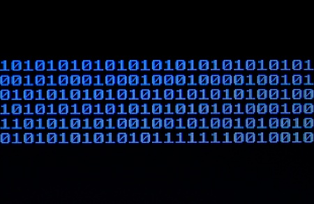 Binary code on a computer monitor. Stock Photo - 13232144